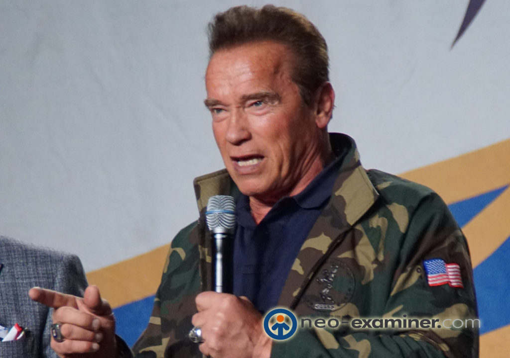 Arnold Schwarzenegger speaking to a crowd at the 29th annual Arnold Sports Festival