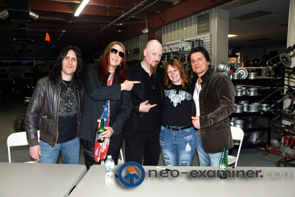 A fan posing with Steelheart who delayed her cancer treatments to stay healthy for the concert