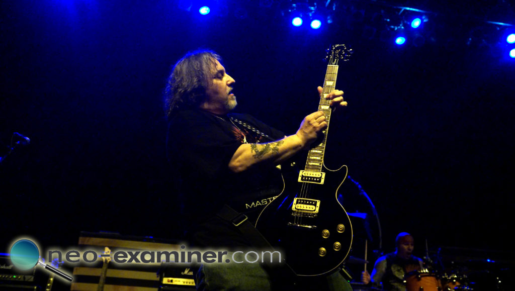 Dom playing guitar for Mourning Wagon while opening up for Stryper